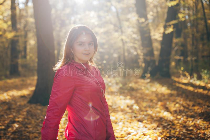 Young girl trains in the morning autumn park. Close up portrait royalty free stock photos