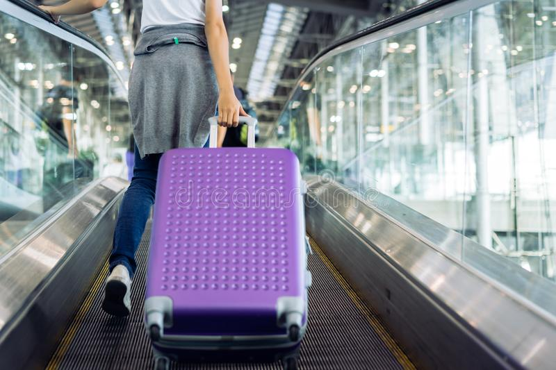 Young girl travel walking with carrying. Hold suitcase luggage and passenger for tour travel booking ticket flight in airport international vacation time in royalty free stock photo