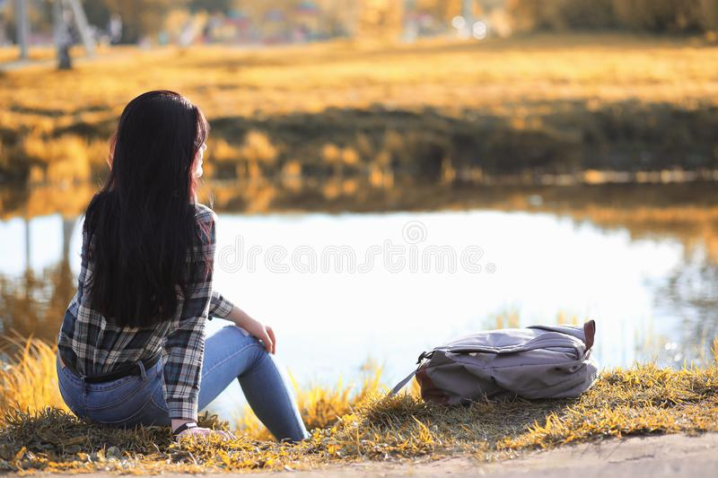 A young girl is traveling around the city hitchhiking. A beautif royalty free stock photos