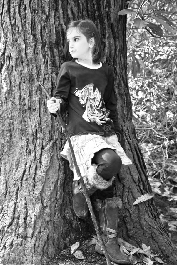 Young Girl and Tree/Black/White royalty free stock image