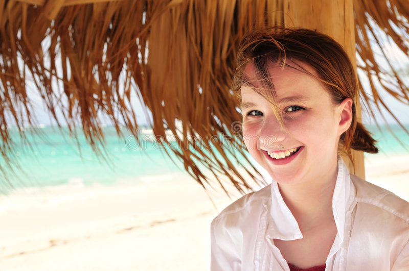 Young girl on tropical beach royalty free stock photo