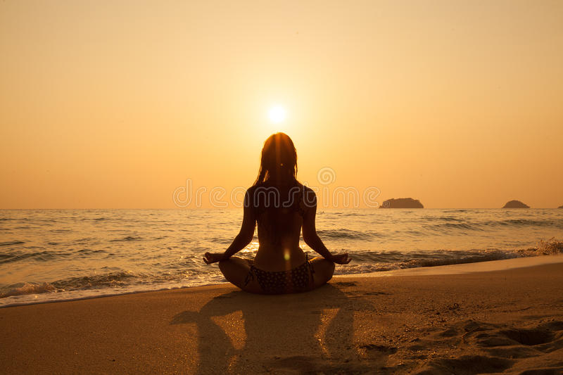 Young girl on a tropical beach at sunset. Summer vacation conce royalty free stock photos