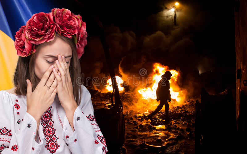 Young girl in the Ukrainian national suit. Patriotic concept. Sorrowful beautiful young girl in Ukrainian national suit covers her face with her €‹hands royalty free stock photography