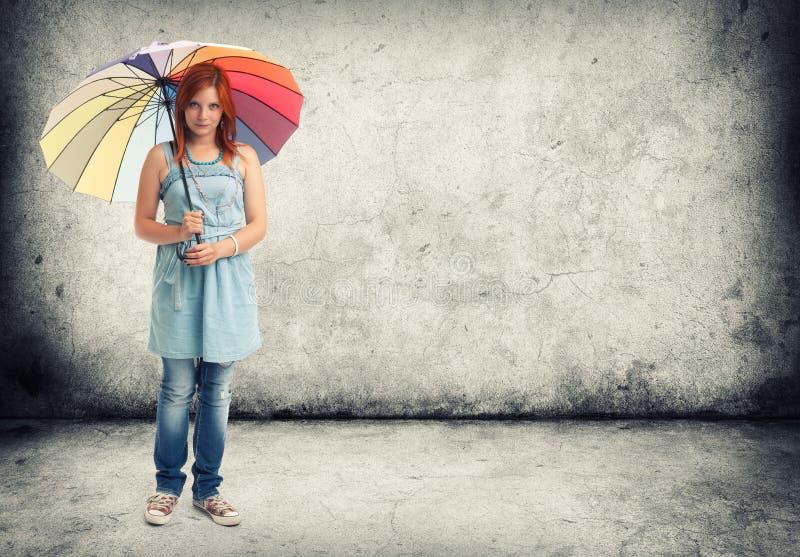 Young girl with an umbrella royalty free stock photos