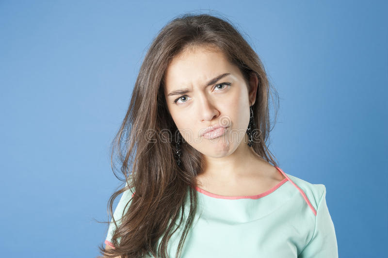 Young girl with unhappy expression. royalty free stock images