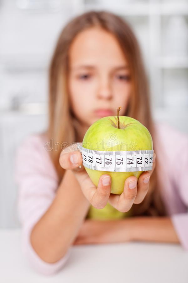 Young girl unhappy about her healthy diet choices - the effort of being fit stock image