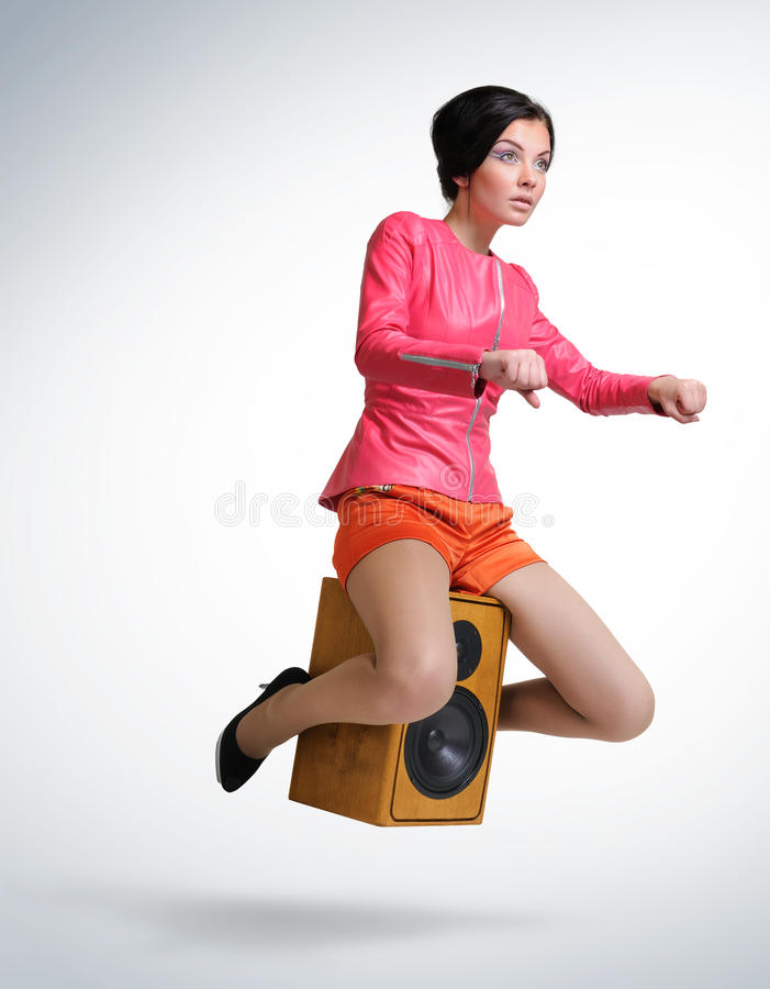 Young Girl Unreal Flies On Speaker Stock Images