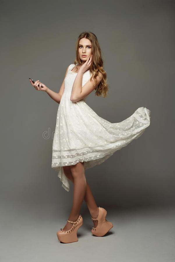 Young girl in unusual lace dress. Young beautiful girl in unusual lace dress royalty free stock photos