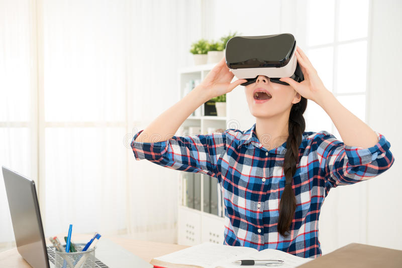 Young Woman Wearing Virtual Reality Glasses At Home Stock