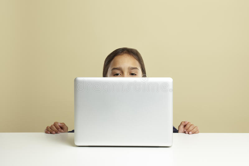 Young girl using laptop stock photography