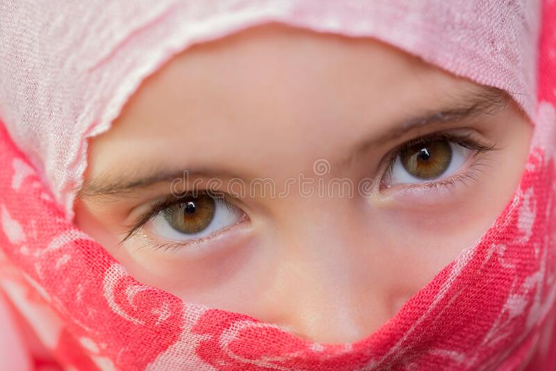 Young veiled girl stock photo