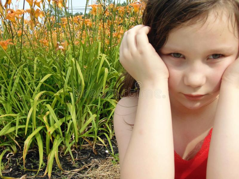 Young Girl With Vivid orange Flowers royalty free stock photo