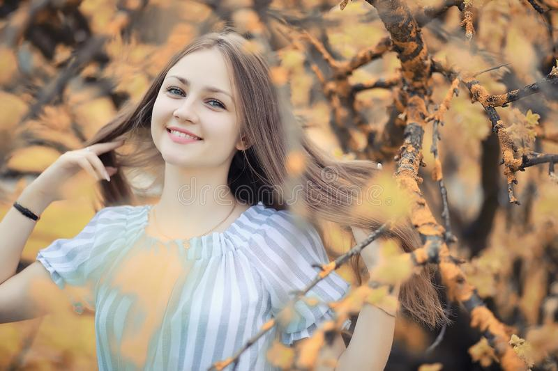 Young girl on a walk in the autumn. Parkr stock photography