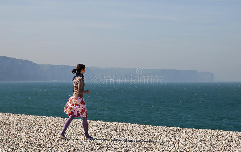 Download Young Girl Walking On The Beach Stock Photography - Image: 26347702