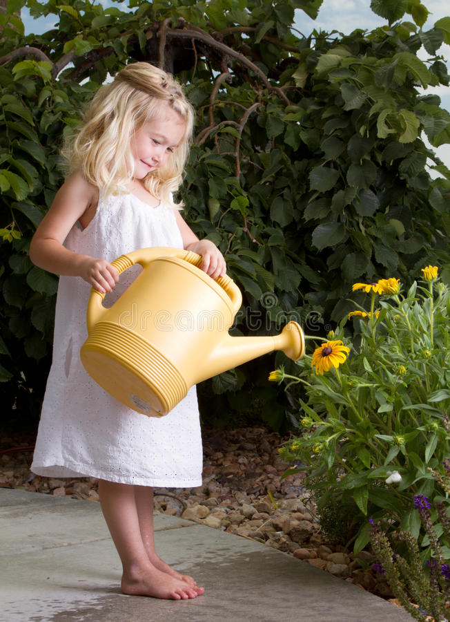 Download Young Girl Watering Flowers Royalty Free Stock Images - Image: 25677779