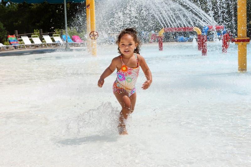 Young girl at a waterpark stock photos