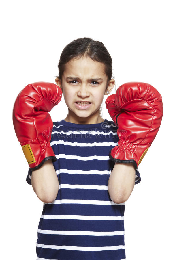 Young girl wearing boxing gloves angry royalty free stock images