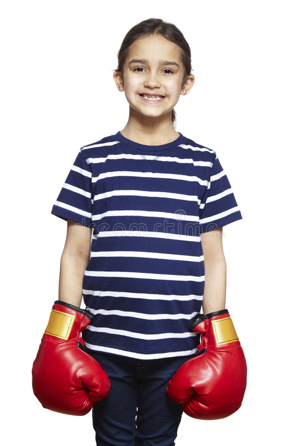 Young girl wearing boxing gloves smiling stock photo