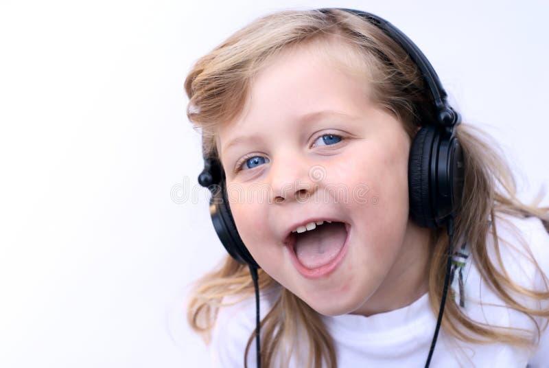 Young girl wearing headphones stock image