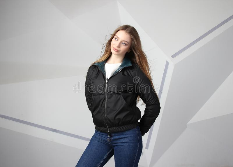 Young girl girl wearing  jacket with area for your logo, mock-up of white women hoodie stock image