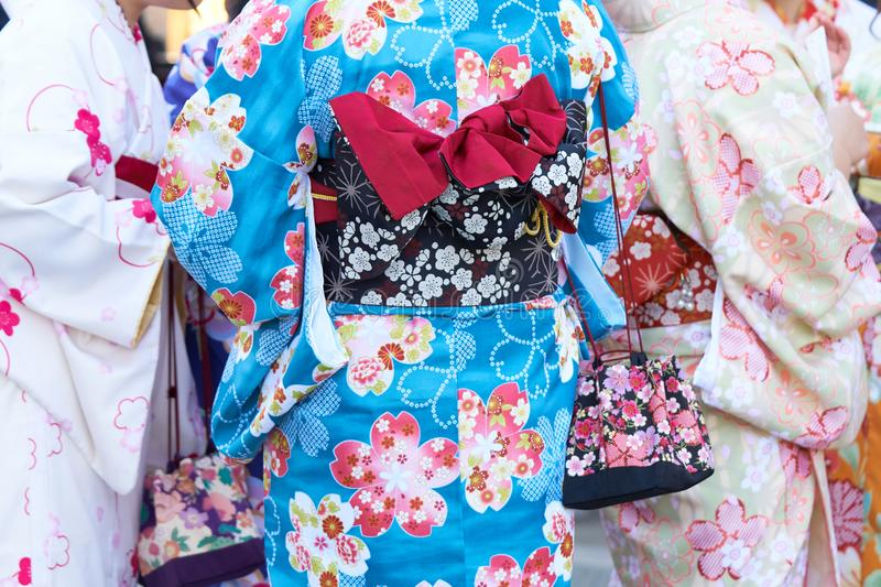 Young girl wearing Japanese kimono standing in front of Sensoji Temple in Tokyo, Japan. Kimono is a Japanese traditional garment. The word `kimono`, which stock images