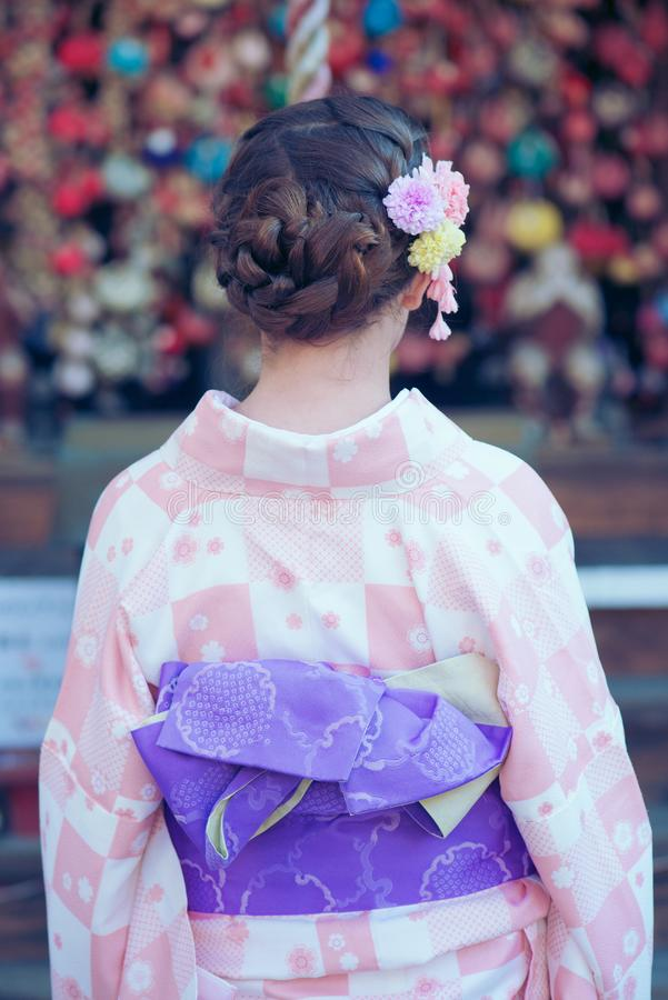 Young girl wearing a kimono stock photography