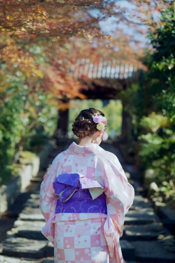 Young girl wearing a kimono stock photos