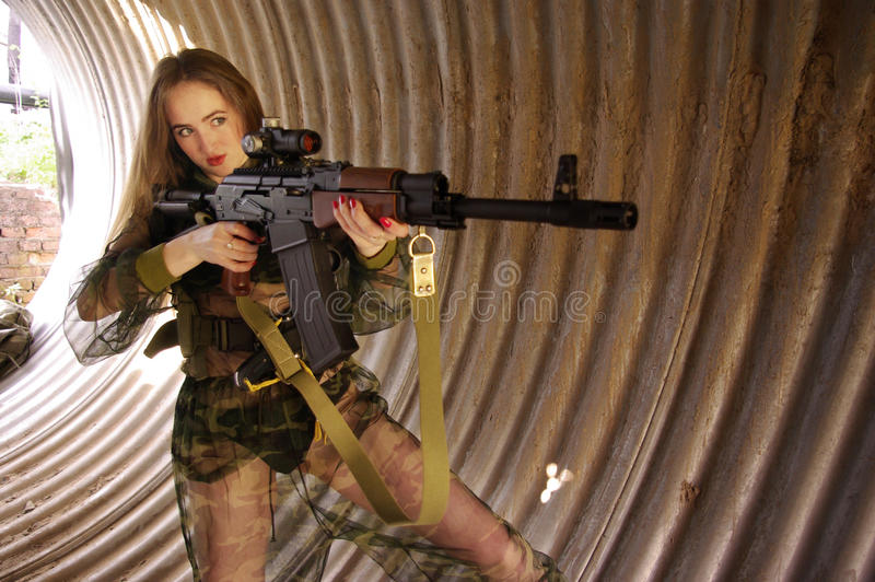 Young girl wearing military uniform stock photo