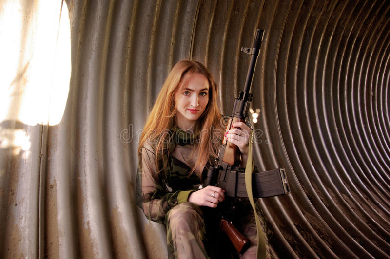 Young girl wearing military uniform royalty free stock photography