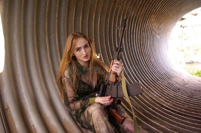 Young girl wearing military uniform stock photos