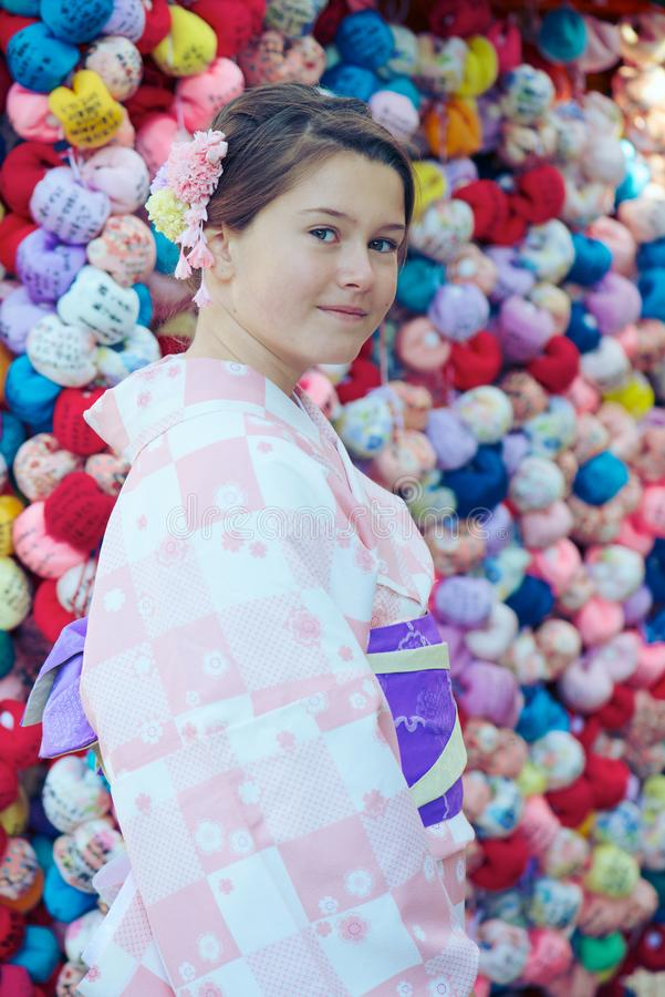 Young girl wearing a kimono royalty free stock images