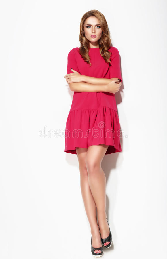 Young girl wearing red dress. stock photo