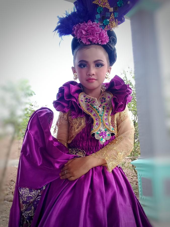 A young girl wearing traditional clothing typical of East Java stock photo
