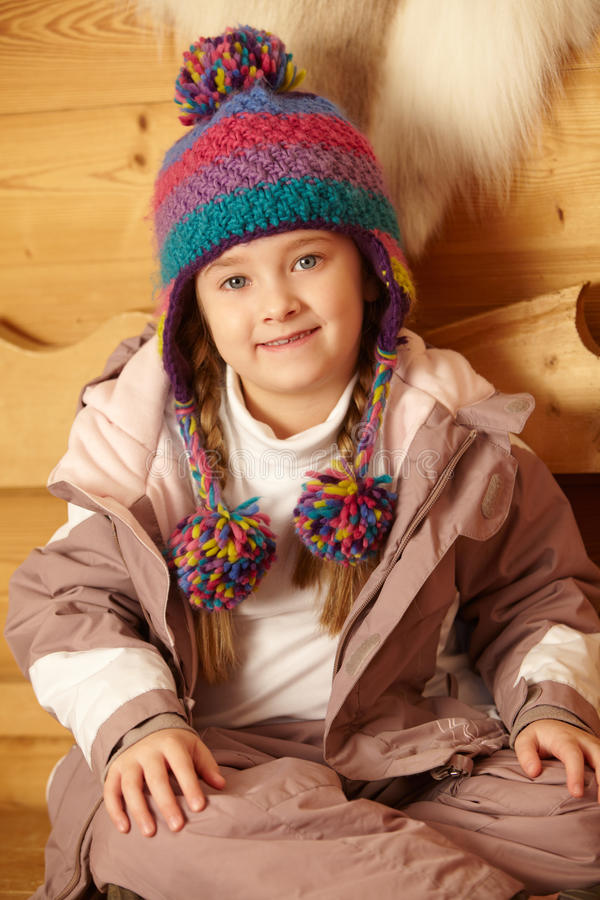 Download Young Girl Wearing Warm Outdoor Clothes Stock Photo - Image of sitting, home: 24382400