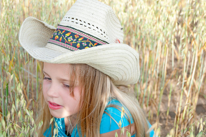 Young girl wearing western style hat royalty free stock photos