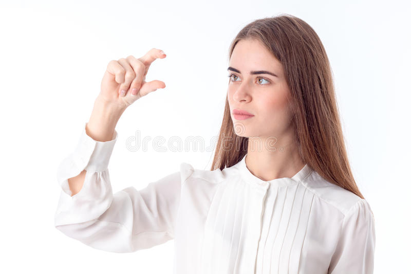 Young girl in white shirt raised one arm up with bent fingers isolated on background. Girl in white shirt raised one arm up with bent fingers isolated on white stock image