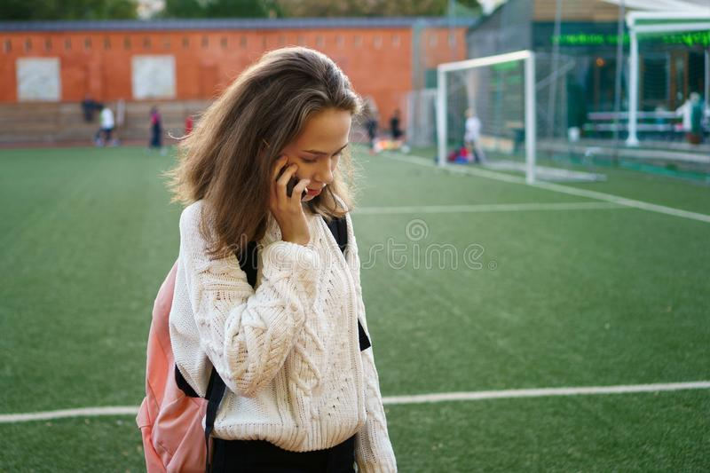 High school girl is calling royalty free stock photo