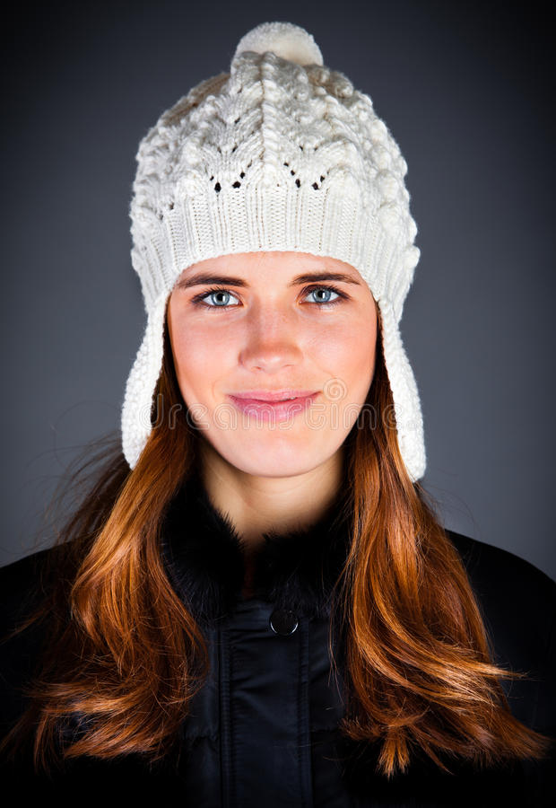 Young Girl In A Winter Cap On The Dark Stock Photography