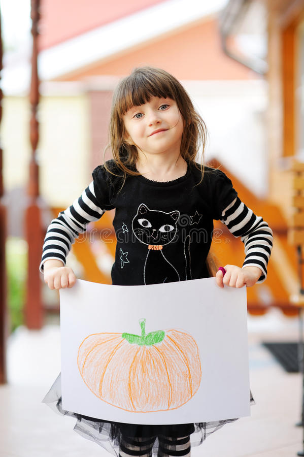 Free Young Girl With Halloween Pumpkin Drawing Stock Photography - 20876822