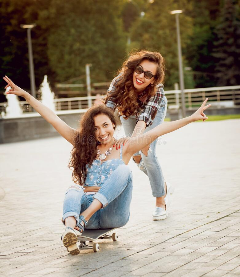 Free Young Girl With Skateboard On The Background Of The Big Gray Wall. Stock Photo - 185973850