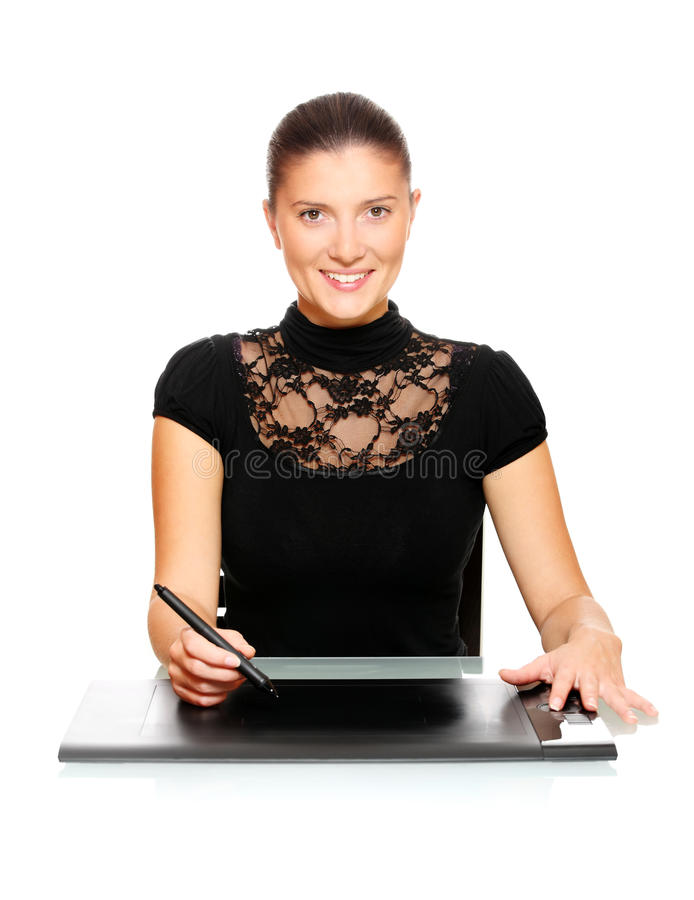 Young girl working on a digital tablet. A portrait of a young beautiful woman working on a digital tablet royalty free stock photo