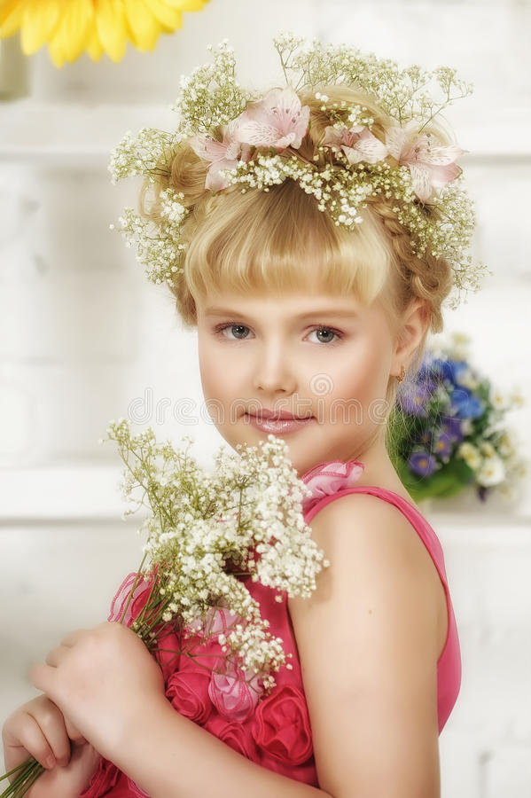 Young flower girl stock photo