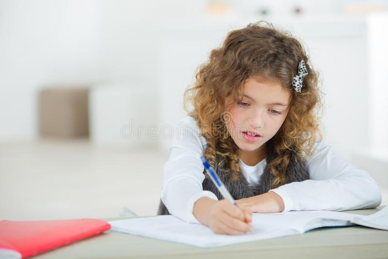 Young girl writing royalty free stock image