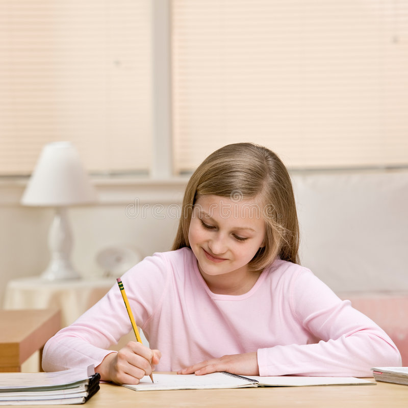 Download Young Girl Writing Homework In Notebook Stock Photo - Image: 6581402