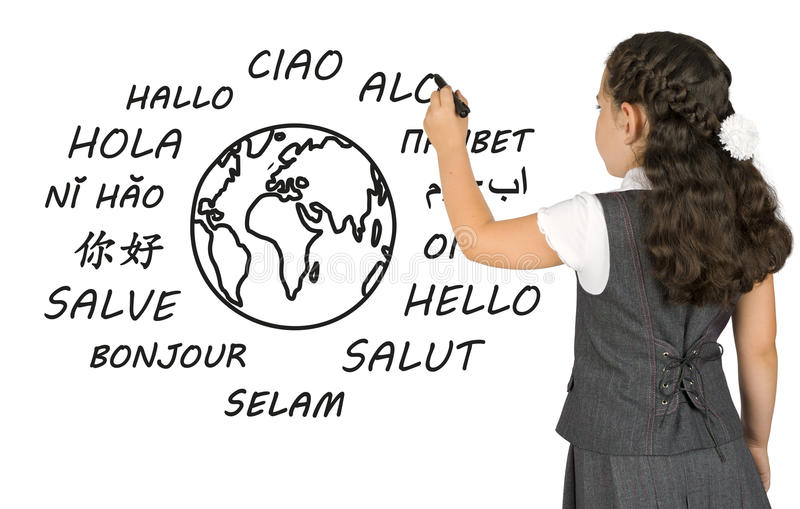 Young girl writing on white board the word Hello. In different languages stock photo