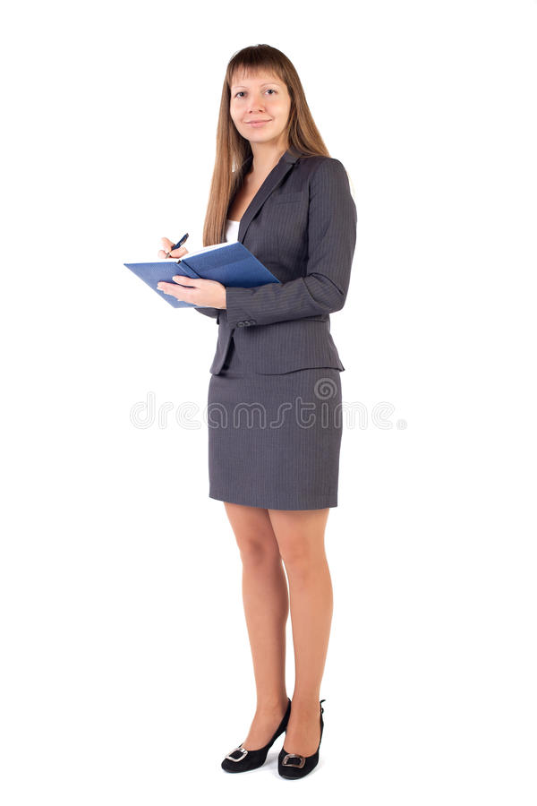 A young girl wrote in a notebook pen stock photography