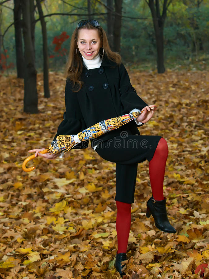 Young Girl With Yellow Umbrella In Fall Outdoor Royalty Free Stock Images