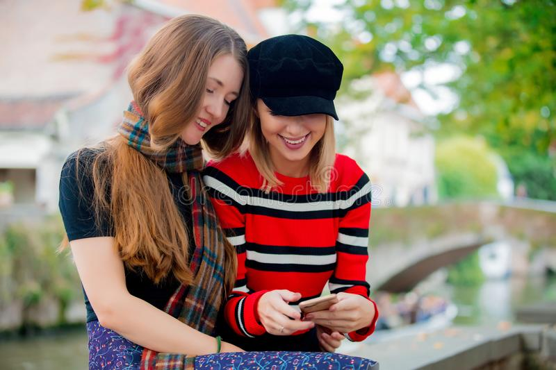 Young girlfriends making a selfie on bridge in Bruges,. Belgium. Autumn season royalty free stock image