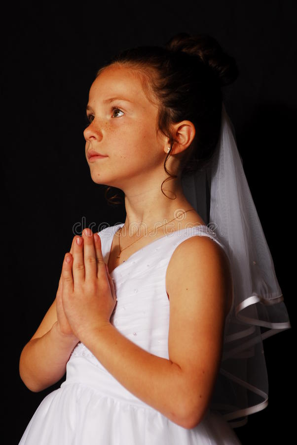 Young girls 1st Communion Portrait. Young catholic girl poses for her First Communion portrait stock images