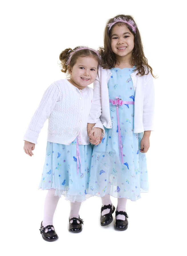 Young Girls. Two young girls all dressed up. Sisters stock photos